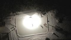 AERIAL - Ice hockey on homemade rink - stock footage