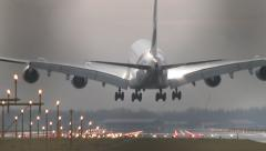 4K Airbus A380 landing on the runway, seen through gate Stock Footage