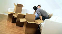 Happy Asian Chinese Couple Surrounded Home Moving Cartons - stock footage