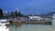 Stock Video Footage of Kind on Yalta from a pier