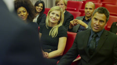 Cheerful diverse business team attend business presentation in lecture theatre - stock footage