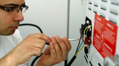 Electrician wiring appliance - stock footage