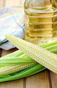 Corncob with oil on board Stock Photos