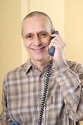 smiling man on phone - stock photo