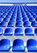 "sector of the stadium with the inscription ""a"" with blue chairs - stock photo"