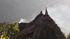 Smoke from a thatched roof in Batad, Philippines. Stock Footage
