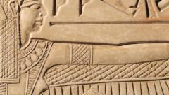 Egyptian carving of Goddess Maat, tracking - stock footage