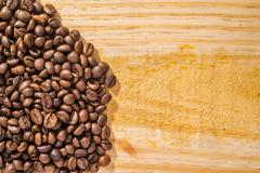 Coffee beans and wood Stock Photos