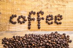 coffee beans and wood - stock photo