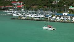 British Virgin Islands Tortola Road Town 071 a catamaran is going to the marina Stock Footage