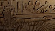Stock Video Footage of Egyptian hieroglyphic carvings revealed by moving light