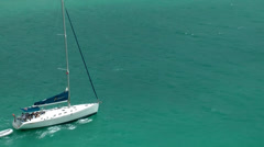British Virgin Islands Tortola Road Town 070 a sailing boat with a dinghy Stock Footage