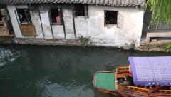 cruise boat in Chinese ancient town, Zhouzhuang - stock footage