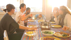 Group of friends eating lunch at home - stock footage