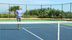 Active Young Caucasian Male Female Enjoying Tennis Stock Footage