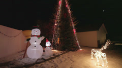 Snowman, Deer, Tree Colorful Christmas Holiday Light Show Stock Footage