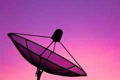 Satellite dish in sunrise Stock Photos
