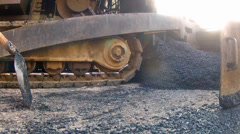 Clip of heavy equipment asphalt laying machine dropping blacktop tar onto new Stock Footage