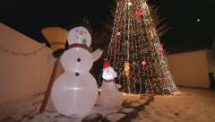 Inflatable Snowman Colorful Christmas Holiday Light Show Stock Footage
