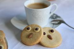 two owl biscuits and a cup of coffee - stock photo