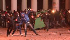Protesters attacked police, throwing stones, set cars alight Stock Footage