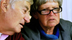 Closeup of retired troubled elder man and woman - stock footage