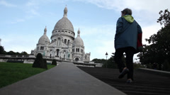 Woman walking to the Sacre Coeur in Paris. - stock footage