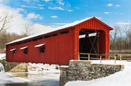 Stock Photo of Red Covered Bridge with Snow