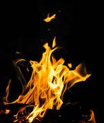 Flame fire on black background Stock Photos