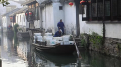 A boat delivering goods along the canal in Chinese ancient town, Zhouzhuang Stock Footage