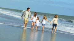 Caucasian Family Casual Clothing Enjoying Walking Beach - stock footage