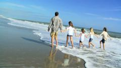 Happy Caucasian Parents Girls Walking Outdoors Fall Beach Stock Footage