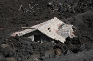 Stock Photo of etna destructed house