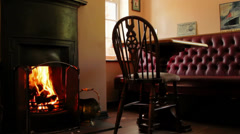 Warm fireplace and seating area, country pub Stock Footage