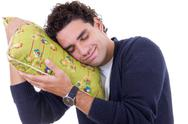 Stock Photo of man with a pillow dreaming while and resting peacefully with serenity