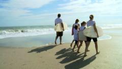 Young Caucasian Girls Parents Beach Bodyboard Surfboard - stock footage