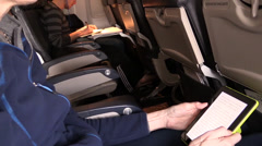 Airplane passenger passing time Stock Footage