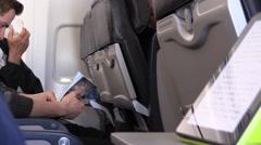 Airplane passenger reading Stock Footage