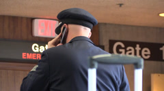 Airplane pilot , cell phone Stock Footage