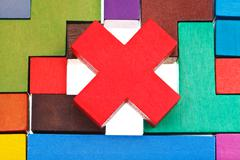 cross shaped block on wooden puzzle - stock photo