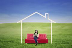 Asian female working on laptop in dream house outdoor Stock Illustration
