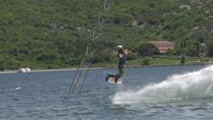 SLOW  MOTION: Professional wakeboarder jumps high Stock Footage