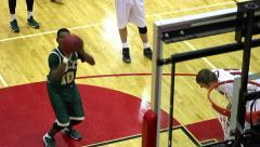 Cool angle of high school basketball player shooting free throw Stock Footage