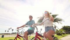 Young Happy Couple Riding Bikes At Beach, Summer Lifestyle HD - stock footage