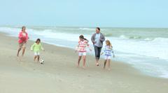 Caucasian Family Warm Clothing Kicking Soccer Ball Beach - stock footage