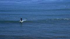Standing Boarders Paddling on Gentle Waves Stock Footage