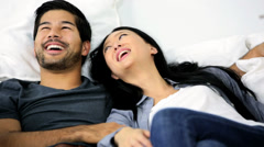 Attractive Ethnic Couple Surrounded Home Moving Cartons Relaxing Sofa Stock Footage
