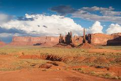 Storm clouds gather over monument valley Stock Photos