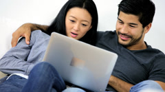 Relaxed Ethnic Couple Laptop Wireless Internet Websites - stock footage