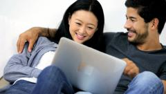 Happy Asian Chinese Couple Laptop Online Websites Close Up - stock footage